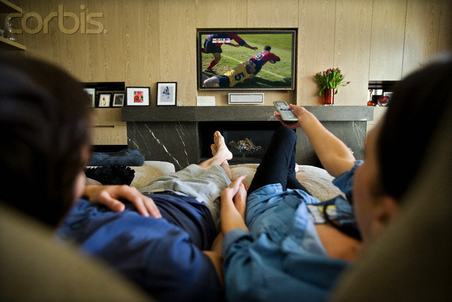 Couple Watching Soccer Game on Television --- Image by © Ken Seet/Corbis